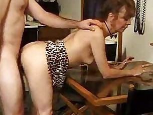 Mature lady licks sperm from table 2