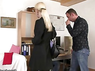 Two dudes share a hot old blonde in the office