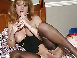 MILF In Black Stockings Sucking Dildo Then Masturbates