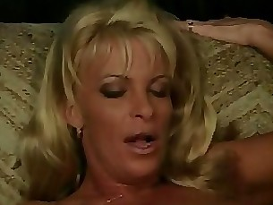 Horny blonde milf on sofa gets her pussy licked by young black guy then fucks