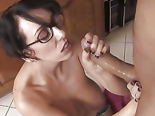 Brunette In Glasses Strokes For A Facial