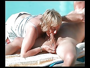 Mature naked and sucking cock in public